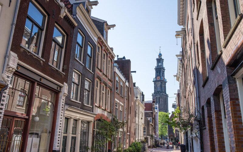 Book Your Eurail/Interrail Adventure at HappyRail | Trip Itineraries for Eurail | Amsterdam Westertoren Unesco Canal Belt
