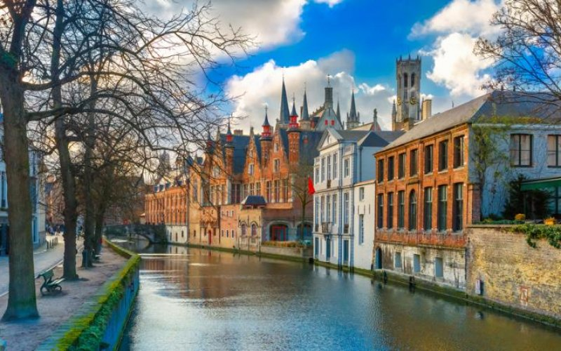 Trains to & from Bruges - old buildings along the river