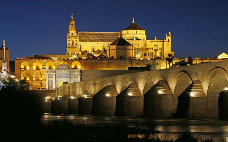 Trains to & from Cordoba | River flowing through Cordoba