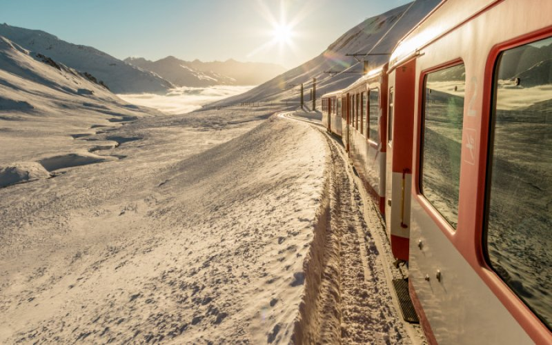 Trains in Switzerland | Swiss Travel Pass | Train running to the sun