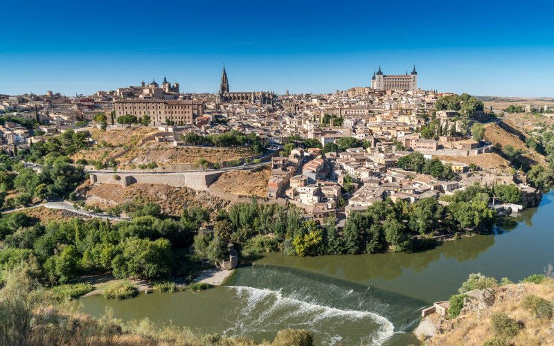 Trains to & from Toledo | Aerial shot of Toledo and river flowing through the city